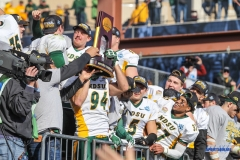FRISCO, TX - JANUARY 06: North Dakota State players lift the trophy after winning the FCS National Championship game between North Dakota State and James Madison on January 6, 2018 at Toyota Stadium in Frisco, TX. (Photo by George Walker/Icon Sportswire)