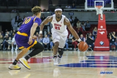 UNIVERSITY PARK, TX - JANUARY 28: Southern Methodist Mustangs guard Ben Emelogu II (21) brings the ball up court during the game between SMU and East Carolina on January 28, 2018 at Moody Coliseum in Dallas, TX. (Photo by George Walker/Icon Sportswire)