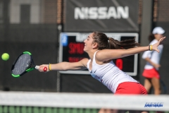 DALLAS, TX - FEBRUARY 4: Charline Anselmo hits a forehand volley during the SMU women's tennis match vs Iowa on February 4, 2018, at the SMU Tennis Complex, Turpin Stadium & Brookshire Family Pavilion in Dallas, TX. (Photo by George Walker/DFWsportsonline)