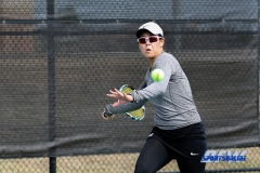 Denton, TX - February 25: Minying Liang during the UNT Mean Green Women's Tennis dual match against the Marshall Thundering Herd at the Waranch Tennis Complex in Denton, TX. (Photo by Mark Woods/DFWsportsonline)