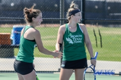 Denton, TX - March 3: Tamuna Kutubidze and Alexandra Héczey during the UNT Mean Green Women's Tennis dual match against the University of Houston at the Waranch Tennis Complex in Denton, TX. (Photo by Mark Woods/DFWsportsonline)
