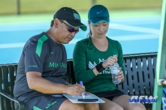 Denton, TX - March 3: Head Coach Sujay Lama discusses strategy with Haruka Sasaki during the UNT Mean Green Women's Tennis dual match against the University of Houston at the Waranch Tennis Complex in Denton, TX. (Photo by Mark Woods/DFWsportsonline)