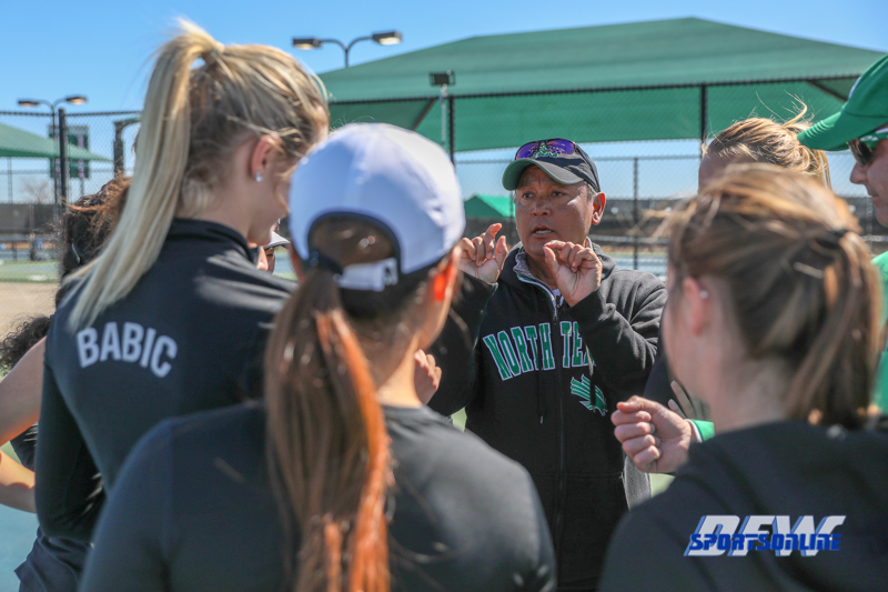 Denton, TX - March 7: Head Coach Sujay Lama shares last minute advice to the team at the UNT Mean Green Women's Tennis dual match against the Middle Tennessee State University at the Warch Tennis Complex in Denton, TX. (Photo by Mark Woods/DFWsportsonanline)