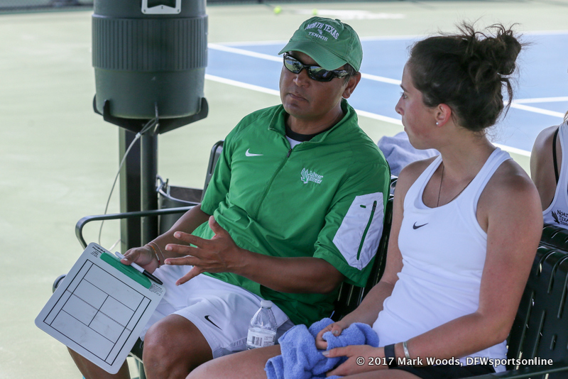 Head Coach Sujay Lama and Tamuna Kutubidze discuss strategy during a court change during the KU match on March 19, 2017 at Waranch Tennis Center.