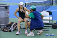 DALLAS, TX - APRIL 16: Volunteer Coach Raj Lama gives Minying Liang pointers between points during the North Texas women's tennis match vs SMU on April 12, 2018, at the SMU Tennis Complex, Turpin Stadium & Brookshire Family Pavilion in Dallas, TX. (Photo by Mark Woods/DFWsportsonline)