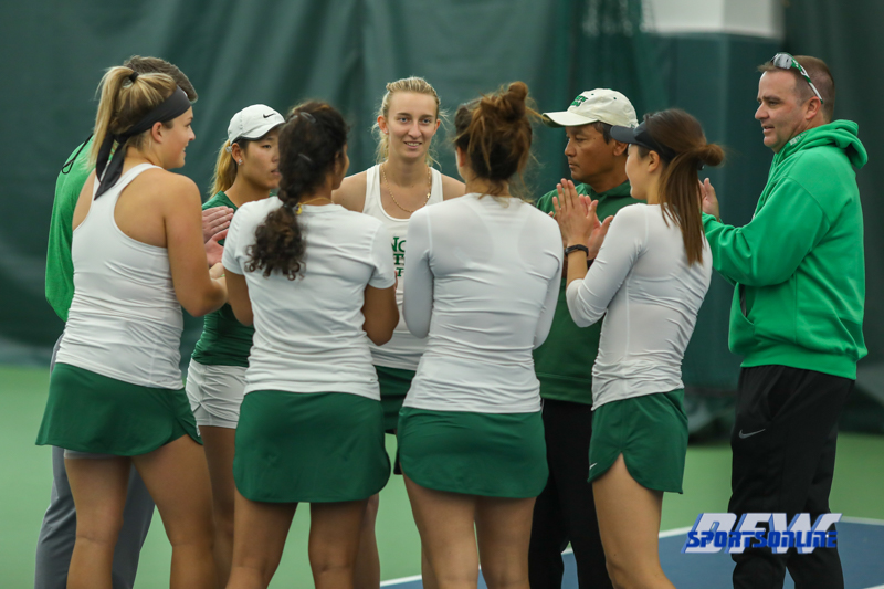 Plano, TX - April 14: Captain Maria Kononova leads the team in their pre-match ritual before the North Texas Women's Tennis dual match against the University of Arlington at the Lifetime Plano Tennis facility in Plano, TX. (Photo by Mark Woods/DFWsportsonline)