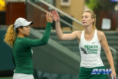 Plano, TX - April 14: Maria Kononova and Minying Liang during the North Texas Women's Tennis dual match against the University of Arlington at the Lifetime Plano Tennis facility in Plano, TX. (Photo by Mark Woods/DFWsportsonline)