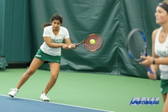 Plano, TX - April 14: Nidhi Surapaneni returing serve during the North Texas Women's Tennis dual match against the University of Arlington at the Lifetime Plano Tennis facility in Plano, TX. (Photo by Mark Woods/DFWsportsonline)