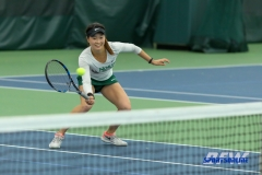 Plano, TX - April 14: Haruka Sasaki volleys during the North Texas Women's Tennis dual match against the University of Arlington at the Lifetime Plano Tennis facility in Plano, TX. (Photo by Mark Woods/DFWsportsonline)