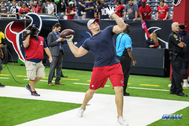 HOUSTON, TX - AUGUST 30: Houston Texans defensive end J.J. Watt (99) passes the football with fans before the preseason game between the Houston Texans and Dallas Cowboys on August 30, 2018, at NRG Stadium in Houston, TX. (Photo by George Walker/DFWsportsonline)