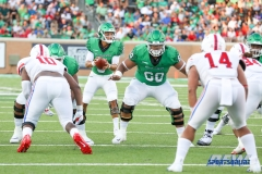 DENTON, TX - SEPTEMBER 01: UNT quarterback Mason Fine (6) drops back to pass during the game between North Texas and SMU on September 1, 2018 at Apogee Stadium in Denton, TX. Defending on the play is offensive lineman Sosaia Mose (60). (Photo by Mark Woods/DFWsportsonline)