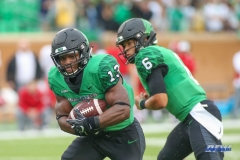 DENTON, TX - SEPTEMBER 08: North Texas Mean Green running back DeAndre Torrey (13) takes a handoff during the game between North Texas and Incarnate Word on September 8, 2018 at Apogee Stadium in Denton, TX. (Photo by George Walker/DFWsportsonline)