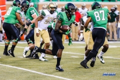 DENTON, TX - SEPTEMBER 23: UNT RUNNING BACK JEFFERY WILSON (11) CARRYING THE BALL DURING THE GAME BETWEEN THE UNT MEAN GREEN AND UAB BLAZERS ON SEPTEMBER 23, 2017, AT APOGEE STADUIM IN DENTON, TEXAS. (PHOTO BY MARK WOODS/DFWSPORTSONLINE)