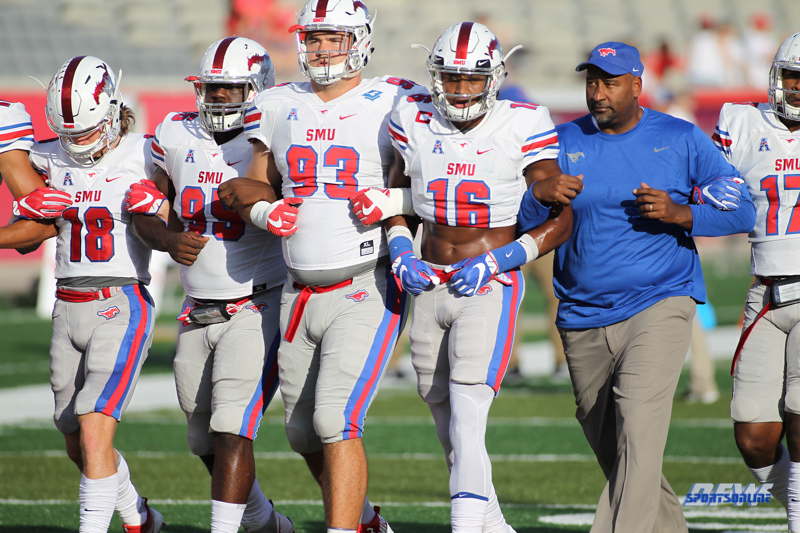 HOUSTON, CA - OCTOBER 07: SMU players lock arms during the game between SMU and Houston on October 7, 2017, at TDECU Stadium in Houston, TX. (Photo by George Walker/DFWsportsonline)