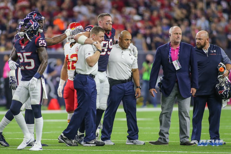 HOUSTON, TX - OCTOBER 08: Houston Texans defensive end J.J. Watt (99) is helped off the field during the game between the Houston Texans and Kansas City Chiefs on October 8, 2017, at NRG Stadium in Houston, TX. (Photo by George Walker/DFWsportsonline)