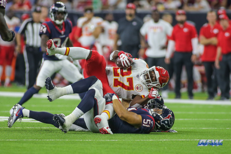 HOUSTON, TX - OCTOBER 08: Kansas City Chiefs running back Kareem Hunt (27) is upended during the game between the Houston Texans and Kansas City Chiefs on October 8, 2017, at NRG Stadium in Houston, TX. (Photo by George Walker/DFWsportsonline)