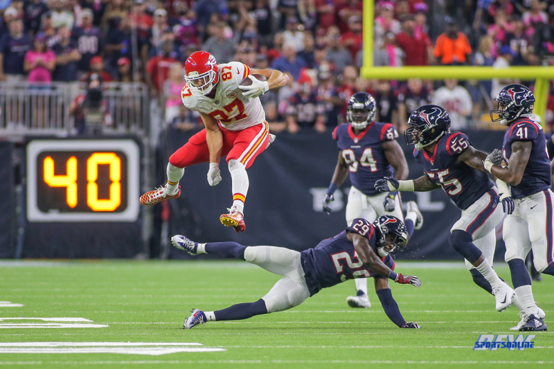 HOUSTON, TX - OCTOBER 08: Kansas City Chiefs tight end Travis Kelce (87) leaps over Houston Texans free safety Andre Hal (29) during the game between the Houston Texans and Kansas City Chiefs on October 8, 2017, at NRG Stadium in Houston, TX. (Photo by George Walker/DFWsportsonline)