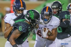 DENTON, TX - OCTOBER 14: North Texas Mean Green safety Kishawn McClain (6) tackles UTSA Roadrunners running back Tyrell Clay (22) during the game between the North Texas Mean Green and UTSA Roadrunners on October 14, 2017, at Apogee Stadium in Denton, Texas. (Photo by George Walker/DFWsportsonline)