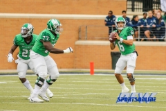 Denton, TX - November 11: North Texas Mean Green quarterback Mason Fine (6) with offensive lineman Elex Woodworth (77) and running back Nic Smith (21) during the game between the North Texas Mean Green and UTEP Miners (Photo by Mark Woods/DFWsportsonline)