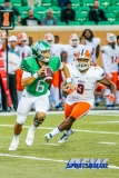 Denton, TX - November 11: North Texas Mean Green quarterback Mason Fine (6) pursued by UTEP linebacker Johnny Jones (8) during the game between the North Texas Mean Green and UTEP Miners (Photo by Mark Woods/DFWsportsonline)