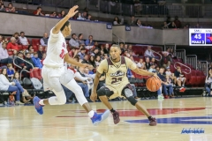 DALLAS, TX - NOVEMBER 12: Louisiana Monroe Warhawks guard Jordon Harris (23) drives to the basket during the men's basketball game between SMU and ULM on November 12, 2017, at Moody Coliseum, in Dallas, TX. (Photo by George Walker/DFWsportsonline)