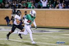 Denton, TX - November 18: North Texas wide receiver Turner Smiley (1) advancing the ball for a touchdown during the game between the North Texas Mean Green and Army West Point Black Knights (Photo by Mark Woods/DFWsportsonline)