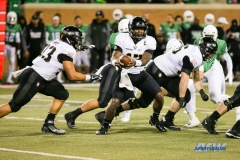 Denton, TX - November 18: Army quarterback Ahmad Bradshaw (17) hands off to running back Darnell Woolfolk (33) during the game between the North Texas Mean Green and Army West Point Black Knights (Photo by Mark Woods/DFWsportsonline)