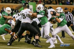 Denton, TX - November 18: Army offensive lineman Brett Toth (78) and North Texas linebacker Joshua Wheeler (18) during the game between the North Texas Mean Green and Army West Point Black Knights (Photo by Mark Woods/DFWsportsonline)