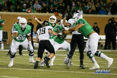 Denton, TX - November 18: North Texas offensive linemen Sosaia Mose (60), Elex Woodworth (77), and Jordan Murray (71) protect quarterback Mason Fine (6) during the game between the North Texas Mean Green and Army West Point Black Knights (Photo by Mark Woods/DFWsportsonline)