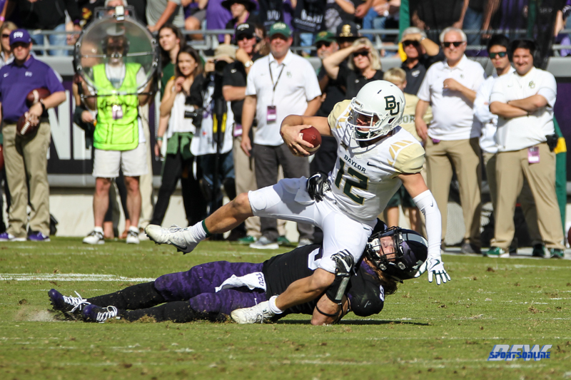 DALLAS, TX - November 24: Baylor Bears quarterback Charlie Brewer (12) is sacked during the game between the Baylor Bears and TCU Horned Frogs on November 24, 2017, at Amon G. Carter Stadium in Fort Worth, Texas. (Photo by George Walker/DFWsportsonline)
