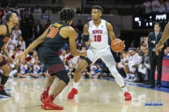 UNIVERSITY PARK, TX - DECEMBER 02: Southern Methodist Mustangs guard Jarrey Foster (10) is guarded by USC Trojans guard Elijah Stewart (30) during the game between SMU and USC on December 2, 2017 at Moody Coliseum in Dallas, TX. (Photo by George Walker/Icon Sportswire)