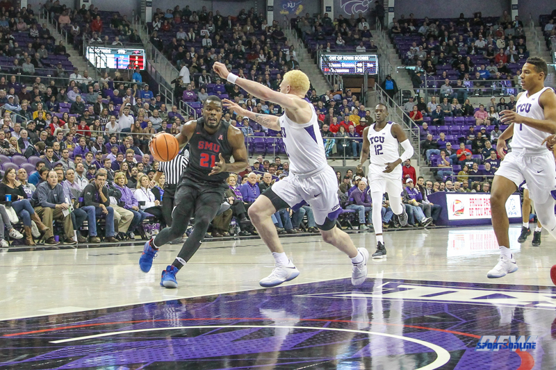 FORT WORTH, TX - DECEMBER 05: Southern Methodist Mustangs guard Ben Emelogu II (21) drives to the basket during the game between SMU and TCU on December 5, 2017 at the Ed and Rae Schollmaier Arena in Fort Worth, TX. (Photo by George Walker/DFWsportsonline