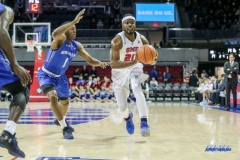 DALLAS, TX - DECEMBER 13: Southern Methodist Mustangs guard Ben Emelogu II (21) looks to pass the ball during the men's basketball game between SMU and New Orleans on December 13, 2017, at Moody Coliseum, in Dallas, TX. (Photo by George Walker/DFWsportsonline)