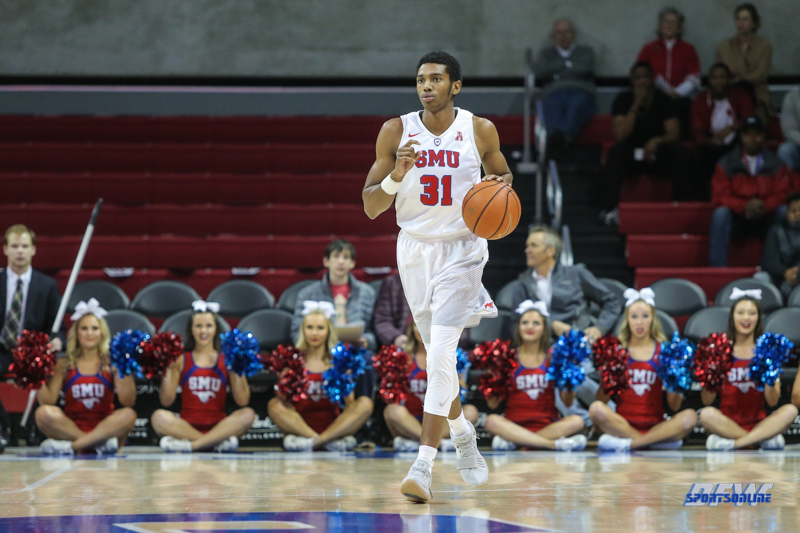 UNIVERSITY PARK, TX - DECEMBER 19: Southern Methodist Mustangs guard Jimmy Whitt (31) brings the ball up court during the game between SMU and Cal Poly State on December 19, 2017, at Moody Coliseum in Dallas, TX. (Photo by George Walker/DFWsportsonline)