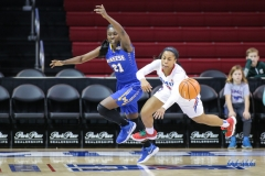 UNIVERSITY PARK, TX - DECEMBER 22: Southern Methodist Mustangs guard Kiara Perry (0) steals the ball from McNeese State Cowgirls forward Mercedes Rogers (21) during the women's game between SMU and McNeese State on December 22, 2017, at Moody Coliseum in Dallas, TX. (Photo by George Walker/Icon Sportswire)