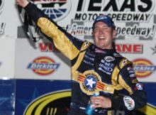 Kurt Busch celebrates in Victory Lane after winning the 2009 NASCAR Dickies 500 at Texas Motor Speedway. Photo by George Walker.