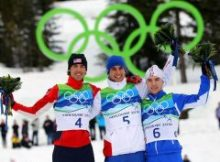 WHISTLER, BC - FEBRUARY 14: (L-R) Johnny Spillane (silver) of United States, Jason Lamy Chappuis (gold) of France and Alessandro Pittin (bronze) of Italy pose during the flower ceremony following the Nordic Combined Men's Individual 10km on day 3 of the 2010 Winter Olympics at Whistler Olympic Park Cross-Country Stadium on February 14, 2010 in Whistler, Canada. (Photo by Lars Baron/Getty Images)