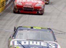 Jimmie Johnson pulls away from Tony Stewart and Kurt Busch to win his first career race at Bristol Motor Speedway. Credit: Doug Pensinger/Getty Images for NASCAR