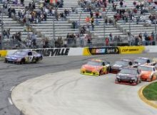 After starting the green-white-checkered finish in fourth position, Denny Hamlin pushed his way to the front of the field and took the lead when Matt Kenseth cut across the field but couldnt stay in the groove. Credit: John Harrelson/Getty Images for NASCAR