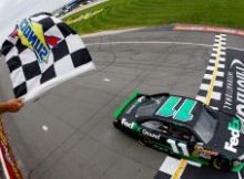 Denny Hamlin takes his fifth checkered flag in the last 10 NASCAR Sprint Cup Series races this season on Sunday at Michigan International Speedway in Brooklyn, Mich. Credit: Chris Trotman/Getty Images