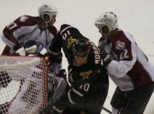 Brenden Morrow of the Dallas Stars goes between Colorado Avalanche defenders. Photo by George Walker