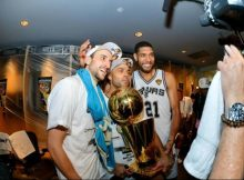 Manu Ginobili, Tony Parker and Tim Duncan of the San Antonio Spurs celebrate with the Larry O'Brien trophy after defeating the Miami Heat to win the 2014 NBA Finals in Game Five of the 2014 NBA Finals on June 15, 2014 at AT&T Center in San Antonio. Credit: Jesse D. Garrabrant/NBAE/Getty Images