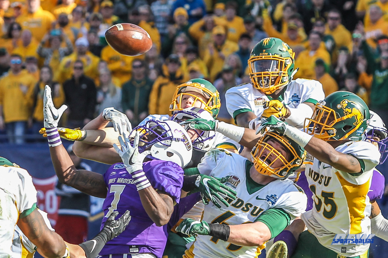 FRISCO, TX - JANUARY 6: Players reach for the ball on a desperation pass attempt by James Madison during the NCAA FCS Championship football game between North Dakota State and James Madison on January 6, 2018 at Toyota Stadium in Frisco, TX. (Photo by George Walker/DFWsportsonline)