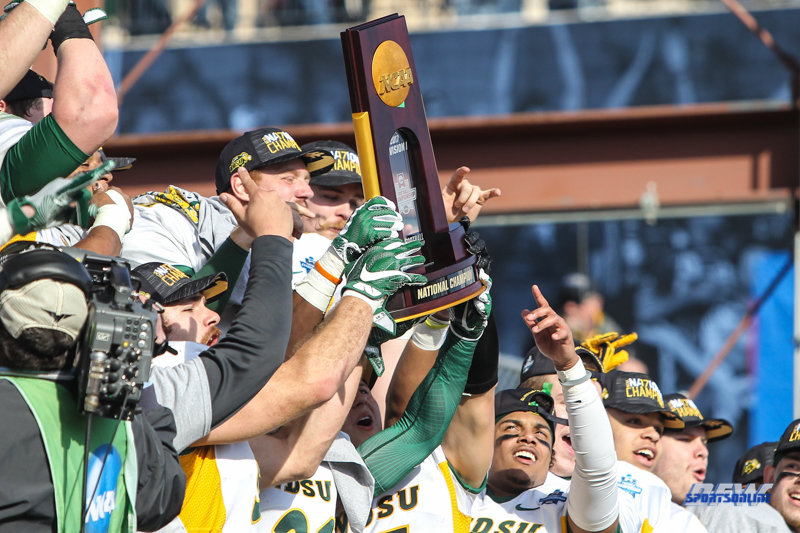 FRISCO, TX - JANUARY 6: North Dakota State players lift the trophy after winning the NCAA FCS Championship football game between North Dakota State and James Madison on January 6, 2018 at Toyota Stadium in Frisco, TX. (Photo by George Walker/DFWsportsonline)