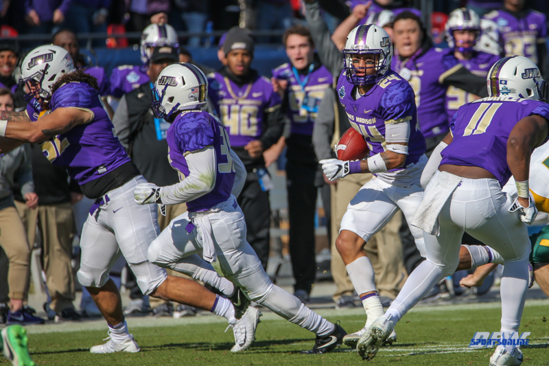 FRISCO, TX - JANUARY 6: James Madison Dukes safety D'Angelo Amos (24) returns a punt during the NCAA FCS Championship football game between North Dakota State and James Madison on January 6, 2018 at Toyota Stadium in Frisco, TX. (Photo by George Walker/DFWsportsonline)
