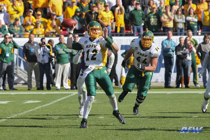 FRISCO, TX - JANUARY 06: North Dakota State Bison quarterback Easton Stick (12) passes during the FCS National Championship game between North Dakota State and James Madison on January 6, 2018 at Toyota Stadium in Frisco, TX. (Photo by George Walker/Icon Sportswire)