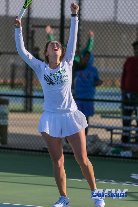 Denton, TX - February 3: Tamuna Kutubidze reacts upon securing the team win at the UNT Mean Green Women's Tennis dual match against the IOWA Hawkeyes on February 3, 2018 at the Waranch Tennis Complex in Denton, TX. (Photo by Mark Woods/DFWsportsonline)