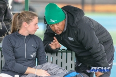 Denton, TX - February 3: Head Coach Sujay Lama discussing the match with Sille Tranberg during the UNT Mean Green Women's Tennis dual match against the IOWA Hawkeyes on February 3, 2018 at the Waranch Tennis Complex in Denton, TX. (Photo by Mark Woods/DFWsportsonline)