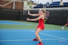 DALLAS, TX - FEBRUARY 09: Nicole Petchey volleys during the SMU women's tennis match vs UCF on February 9, 2018, at the SMU Tennis Complex, Turpin Stadium & Brookshire Family Pavilion in Dallas, TX. (Photo by George Walker/DFWsportsonline)