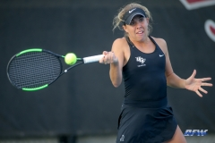 DALLAS, TX - FEBRUARY 09: UCF player hits a forehand during the SMU women's tennis match vs UCF on February 9, 2018, at the SMU Tennis Complex, Turpin Stadium & Brookshire Family Pavilion in Dallas, TX. (Photo by George Walker/DFWsportsonline)